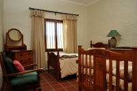 Furnished twin bedroom ¾ antique beds.